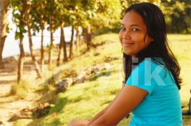 Young Smiling Woman Sitting on the Grass | Photos and Images | Concept