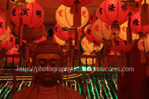 buddha under lanterns