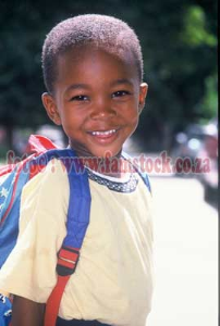 K5153 - toddler with backpack in bright tropical sunlight | Photos and Images | Children
